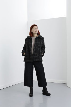 Grey checkered wool jacket with a pleat at the back